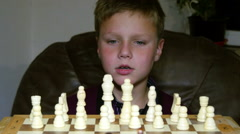 Little Boy Fascinated By The Game Of Chess Stock Footage