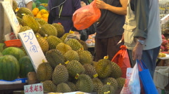 Exotic fresh fruit sale famous street market Hong Kong China traditional bazaar  - stock footage