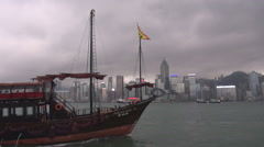 Pan right fallow touristic ship traditional boat Pearl River Hong Kong Island  Stock Footage