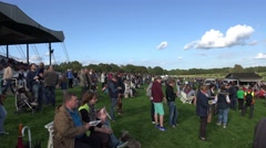 4k Visitors at Horse Racing course waiting for the race panning Stock Footage