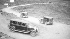 Vintage cars driving, 1930s Stock Footage