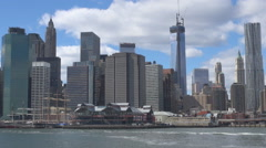 Panoramic view One World Trade Center Famous Pier 17 New York cityscape sunny US Stock Footage
