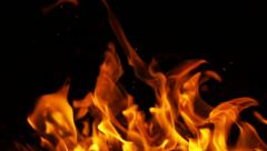 Stock Footage Fire Flames and Sparks on Black Background Slow Motion Stock Footage