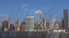 Beautiful New York panorama among dry grass windy day skyline skyscraper blue US Stock Footage