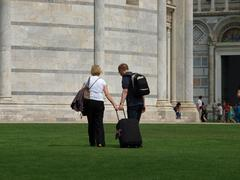 pisa - lost tourists on piazza dei miracoli - stock photo