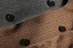 Gray and brown woolen tweed coats overlapping Stock Photos