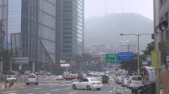 Busy traffic street downtown Seoul fog day smog air pollution  YTN Namsan Tower Stock Footage