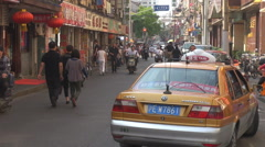 Busy street Shanghai downtown traffic car people traditional shop commercial day Stock Footage
