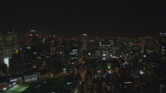 Night panorama Osaka business center financial district tall skyscraper darkness Stock Footage