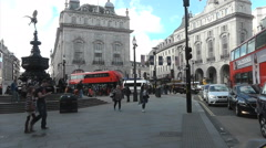 Timelapse Eros watches over Piccadilly circus people and traffic - stock footage