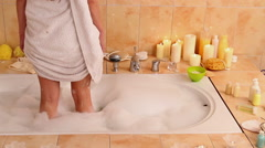 Woman wash leg in bathtube. Stock Footage