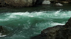 Stock Footage Turn of Rough Mountain Stream in Slow Motion Stock Footage