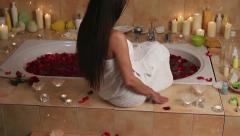 Girl climbs the stairs strewn with rose petals at spa - stock footage