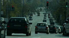 Large boulevard with cars, trams and pedestrians of the high speed Stock Footage
