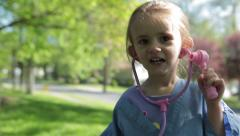 Little girl wants to be a doctor Stock Footage