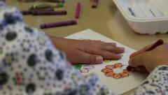 Preschooler coloring in a flower - stock footage