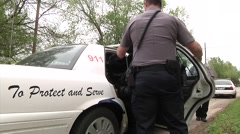 Police loading suspect - stock footage