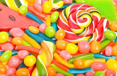 Bright sweets, lollipops, dragee, candies and jelly sweets Stock Photos