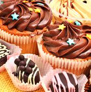 ?hocolate sweets, muffins and coffee grains - stock photo
