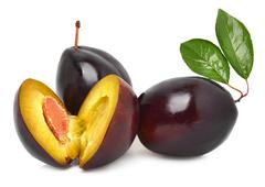 Three sweet plums Stock Photos