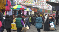 Busy market place downtown Seoul South Korea cloudy day tourism attraction shop Stock Footage