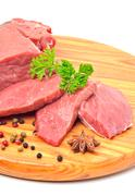 raw beef and meat slices isolated on white - stock photo