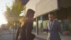 SLOW MOTION CLOSE UP: Angry businessman and businesswoman arguing outdoors - stock footage