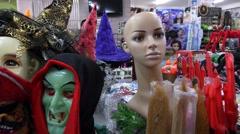 Horrify Halloween Masks in a Shop. Carnival Halloween Celebration. - stock footage