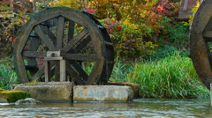 Timelapse of rotating old antique water mills on river. Turning from power of a Stock Footage