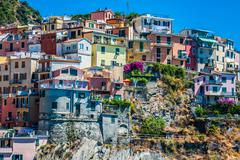 village of manarola with ferry, cinque terre, italy - stock photo