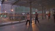 Stock Video Footage of Pedestrian people pass footbridge Shenzhen downtown twilight walkway overpass