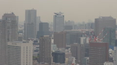 Panoramic view Tokyo skyscraper tall business tower foggy day crane site Asian Stock Footage