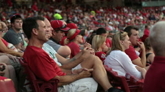 Grandstand and spectators at baseball game Stock Footage