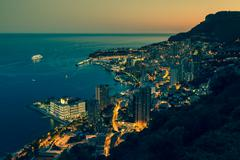Monte carlo in view of monaco at night on the cote d'azur Stock Photos