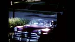 Classic car drives off driveway (vintage 8mm home movies) Stock Footage
