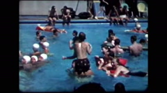 Playing in crowded pool (vintage 8mm home movies) Stock Footage