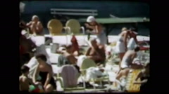 Girl hula hooping by poolside (vintage 8mm home movies) Stock Footage