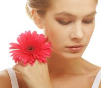 Stock Photo of woman with gerber flower