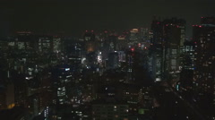 Crowded Tokyo downtown financial center public transportation train pass highway Stock Footage
