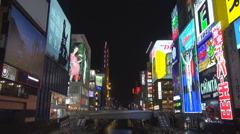 Famous Dotonbori shopping street night Osaka downtown crowded neon sign light Stock Footage