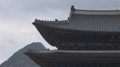 Closeup Geunjeongjeon traditional building rainy day mountain hill Seoul Korea Stock Footage