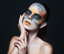 Portrait of beautiful glamor girl with dark eye make-up - stock photo