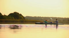 Man and woman paddling boat synchronously. Team-building, sport, click for HD - stock footage