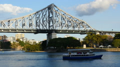 Ferries and boats pass Story bridge in Brisbane TL 4K Stock Footage