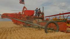 Vintage wheat harvest combine--4K - stock footage