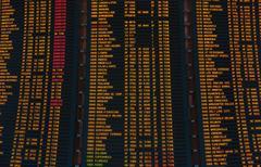 led screen schedule of flights departures - stock photo