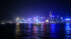 Time Lapse Pan Victoria Harbour / Hong Kong Skyline at Night - Hong Kong China Stock Footage