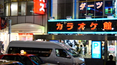 Time Lapse Pan of Busy Shinjuku Entertainment / Shopping District at Night Stock Footage