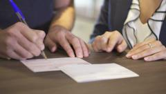 Filling out form closeup Stock Footage