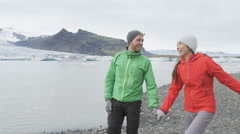 Happy couple holding hands in Iceland nature romantic and laughing Stock Footage